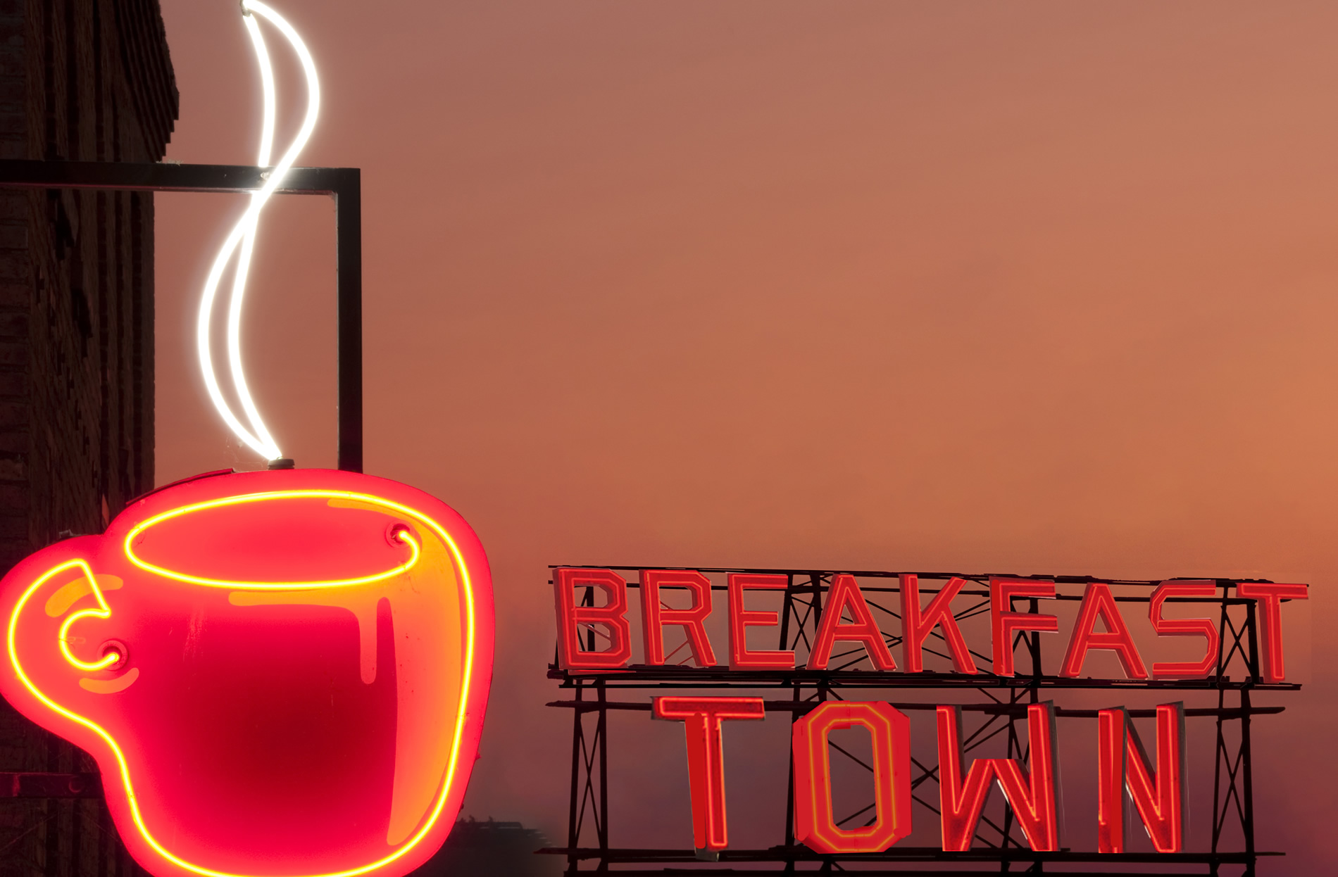 Photo by night of Breakfast Town signage as a creative communications and brand strategy agency in London