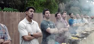 Still from Gillette's TV ad showing men in a row. It's an example of a brave creative idea, discussed in Breakfast Town's blog on the value of creativity in communications