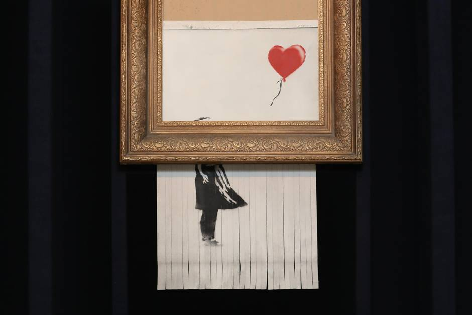 Photo showing how Banksy's Girl With Balloon was shredded at auction and increased the value of the creative idea